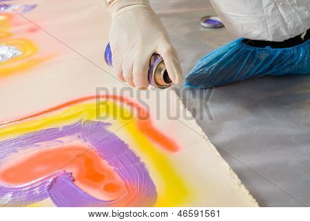 Man spay painting heart shape