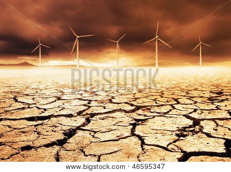 Wind Turbines on a cracked earth desert