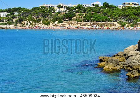 SALOU, SPAIN - AUGUST 10: Vacationers in Platja Llarga beach on August 10, 2012 in Salou, Spain. Salou is a major destination for sun and beach for European tourism with more than 50000 accommodations