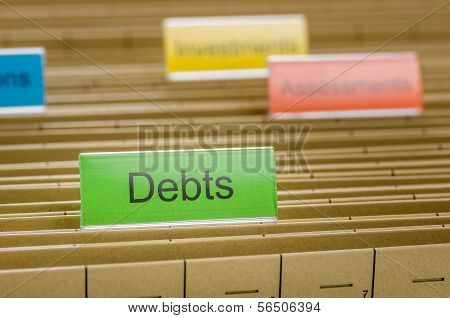 A hanging file folder labeled with Debts