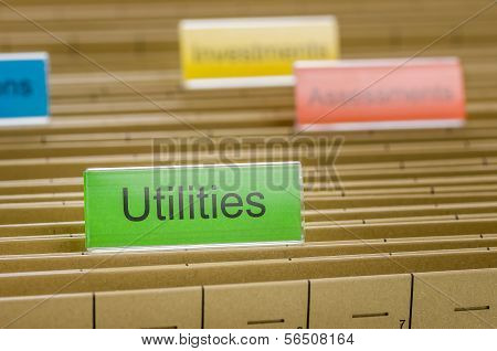 A hanging file folder labeled with Utilities
