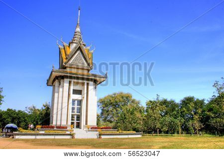 A commemorative stupa filled with the skulls of the victims at the Killing Field of Choeung Ek.