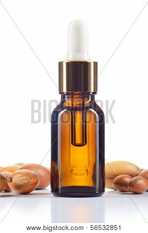 Argan Oil And Argan Nuts On White Background.
