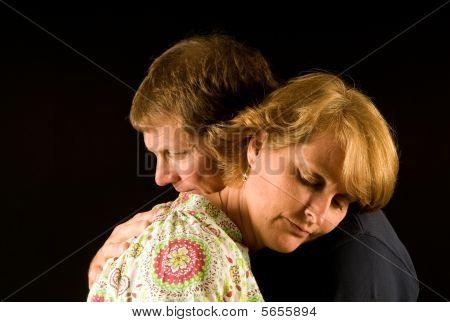 Sad husband and wife hugging