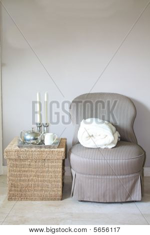 Interior design: classic chair and wicker footstool