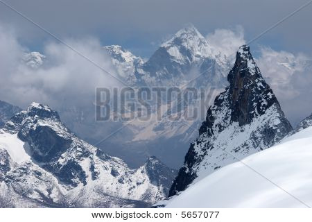 Distant Snow Mountains Across A Valley, Himalaya
