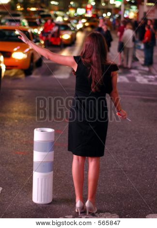 Black Dress Hails A Cab