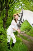 Smiling girl in floral wreath with horse poster