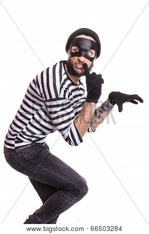 A thief with mask quietly sneaking. Portrait isolated on white background poster
