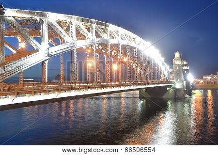Peter the Great Bridge at night (Bolsheokhtinsky Bridge) St.Petersburg Russia. poster