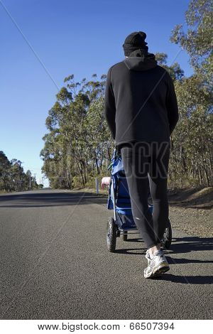 Fit Dad Pushing Baby In A Stroller In The Country