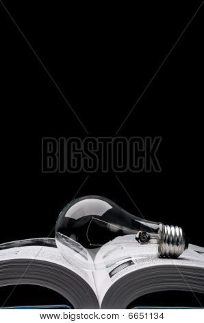 A Lightbulb On A Book Showing Ideas From Inspiration And Education