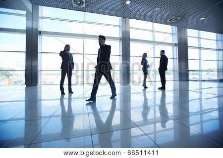 Several office workers on background of window