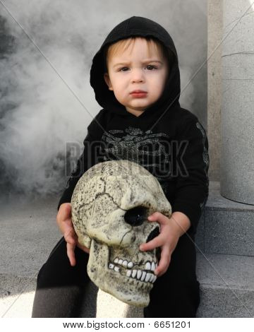 Young boy holding skull