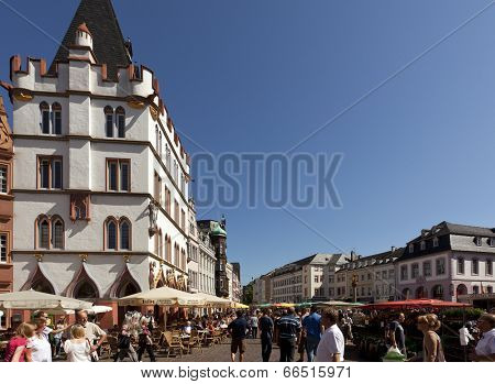 Trier, Germany - August 21, 2010: The crowded Hauptmarkt at Trier, Germany's oldest town. The main marketplace is one of the main tourist attractions.