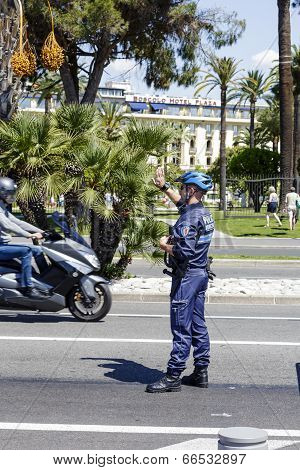 Municipal Policeman Directs Traffic In Nice