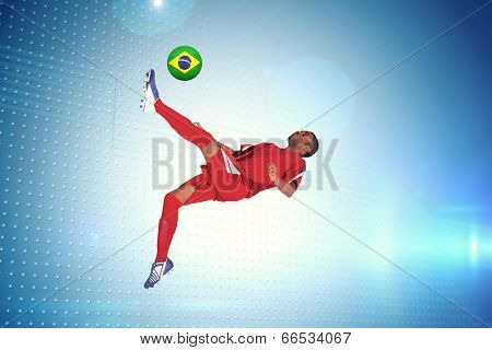 Football player in red kicking against technical screen with pixels poster