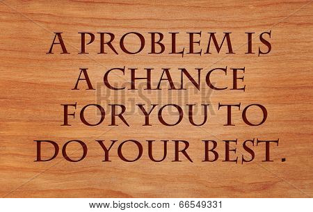 A problem is a chance for you to do your best. - quote on wooden red oak background poster
