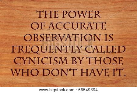 The power of accurate observation is frequently called cynicism by those who don't have it  - quote  on wooden red oak background  poster