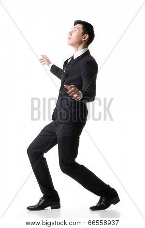 Asian business surprised with outrageously pose, full length portrait isolated on white background.