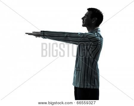 one man in pajamas sleepwalker sleepwalking silhouettes on white background