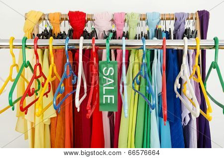 Empty rack of clothes and hangers after a big sale.