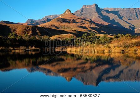 Mountains with symmetrical reflection in water, Royal Natal National Park, South Africa