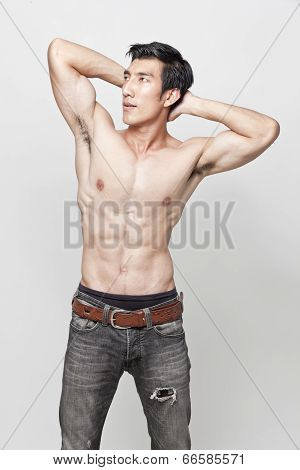 Image of muscle man posing on isolated background. poster