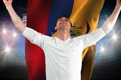 Excited football fan cheering against fireworks exploding over football stadium and ecuador flag poster