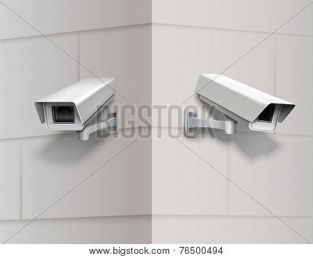 Surveillance cameras on wall