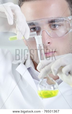 Attractive Young Phd Student Scientist Observing in the Laboratory