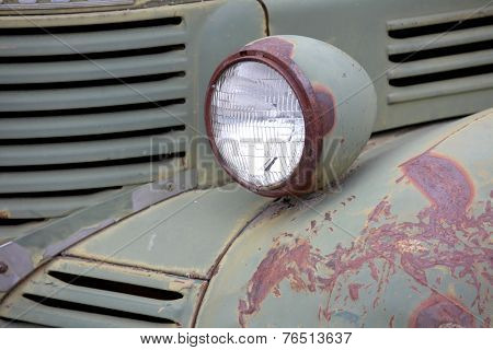 Head lamp of old abandoned truck