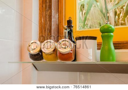 Assorted Colorful Spices In Glass Container