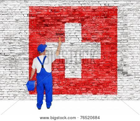 House Painter Covers Wall With Flag Of Switzerland