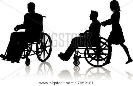 Mann und Frau mit Rollstuhl