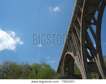 Bridge, sky and trees.