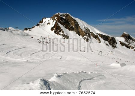 Skiers On Alpine Mountainside