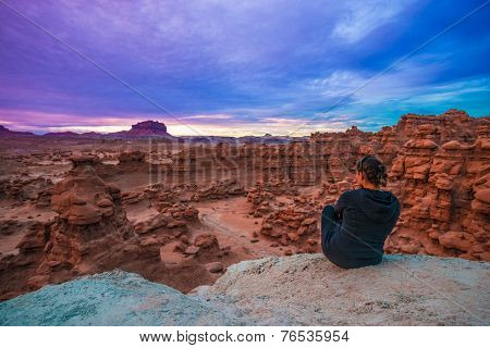 Girl Looking At Sunset Sky Over The Goblin Valley