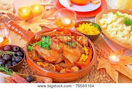 Oven roasted Thanksgiving Turkey on centerpiece of beautiful decorated festive table, healthy and tasty family dinner, traditional autumn holiday