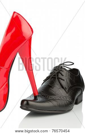 women's shoes on men's shoe, symbol photo for separation, divorce and conflict