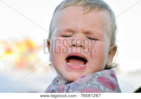 portrait of crying baby girl with sad face poster