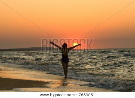 Young Woman In A Sunset