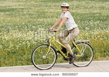 Senior Woman Cycling Outdoors