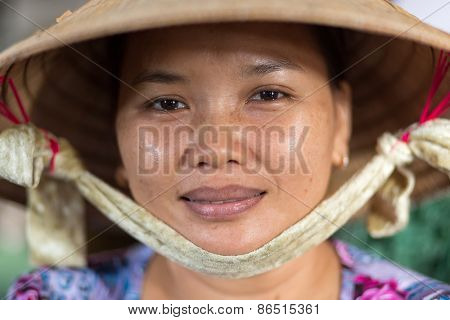 CAN THO, VIETNAM, DECEMBER 11, 2014:Portrait of a woman selling soya milk in the covered Tan An market in Can Tho city, Vietnam.