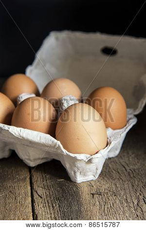 Fresh Eggs In Egg Box In Moody Natural Lighting Vintage Retro Style Set Up