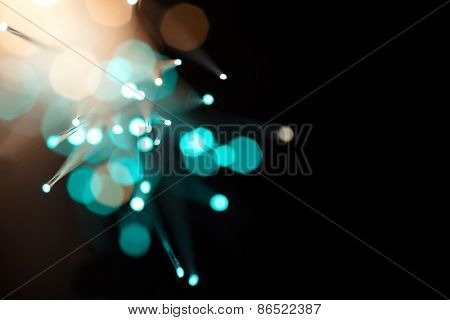 Incoming light through fiber optics abstract background. Soft focus, bokeh background. Intentionally shot with lens flares. poster