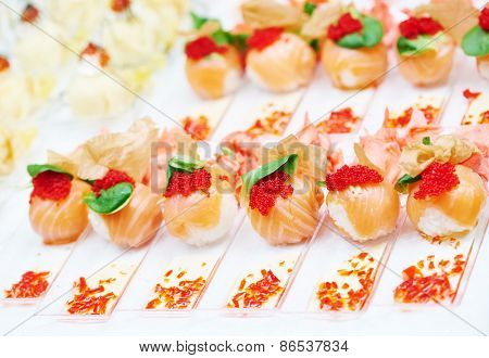 catering services food. authentic sushi rolls on a plate