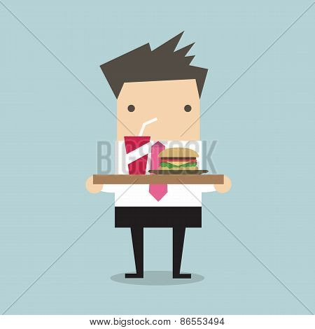 Businessman carrying a tray of food