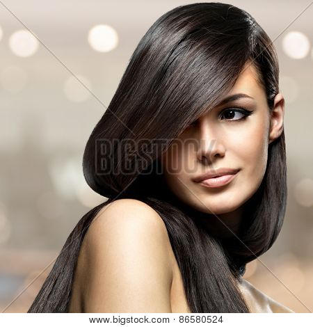 Beautiful woman with long straight hair. Fashion model posing