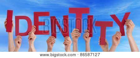 Many People Hands Holding Red Word Identitiy Blue Sky
